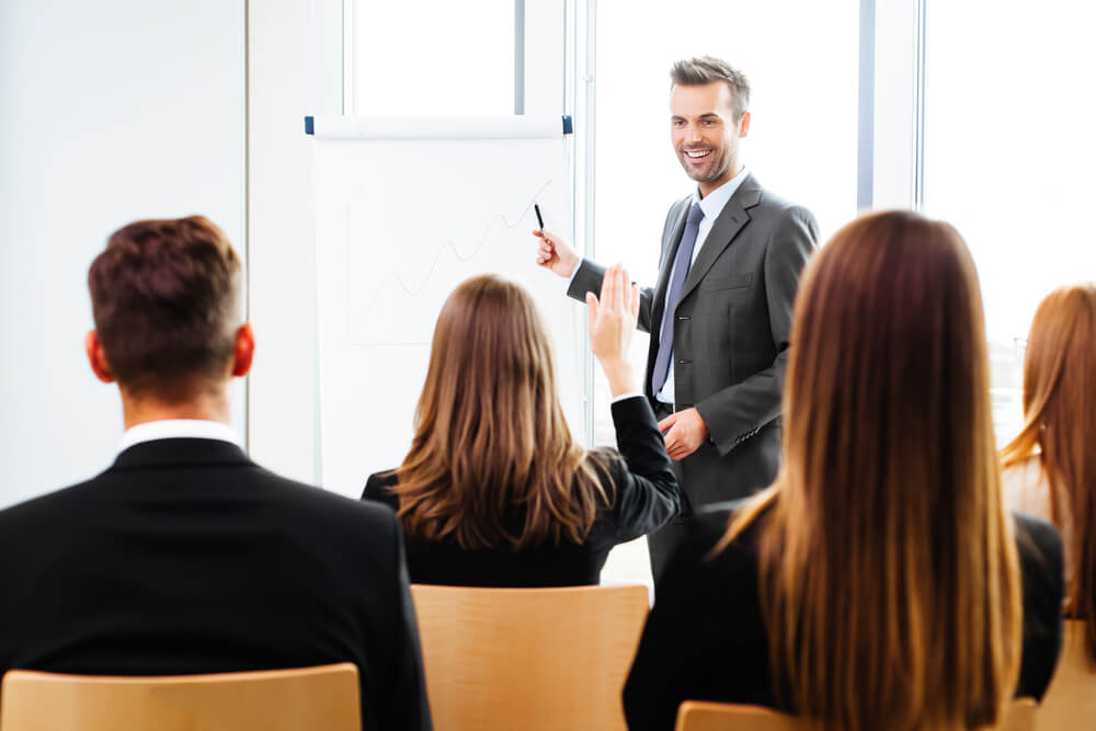 Image result for guy giving a presentation at a meeting