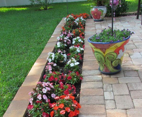 7 Tips To Help You Spruce Up Your Flower Beds And Garden Paths On A Budget