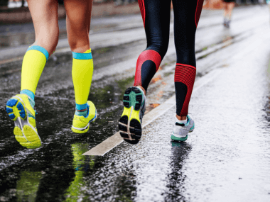 Two runners wearing compression garments