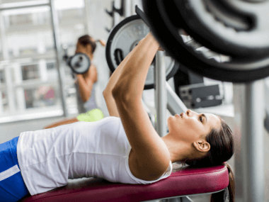 Photo of a woman doing bench press