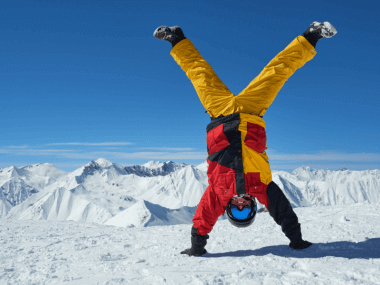 Photo of a skier doing a handstand
