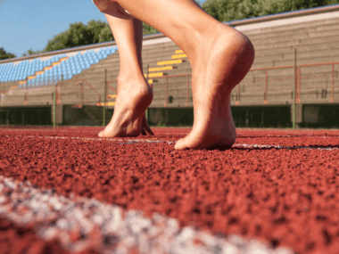 Photo of bare feet on a running track