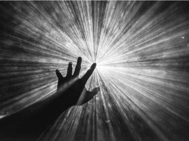 hand reaching toward the light