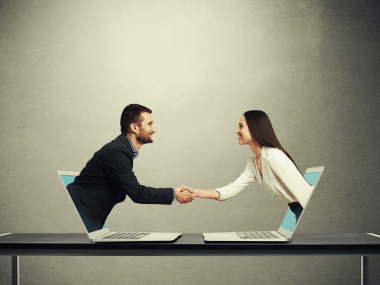 man and woman in business clothing meeting virtually