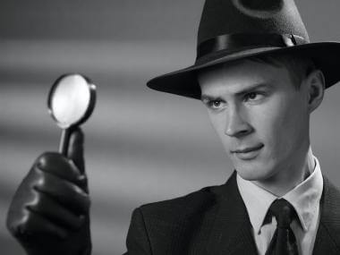 This is a picture of a detective looking for a clue with a magnifying glass