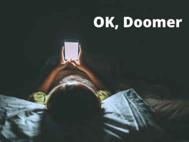 a woman doomscrolling in bed