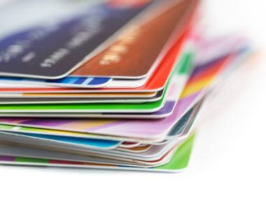 Should I Pay Off High Interest or High Balance Credit Cards First?