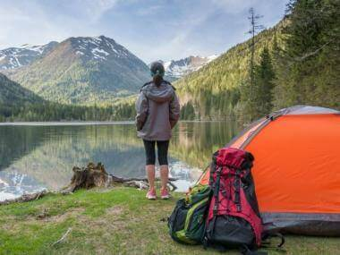 woman camping near lake