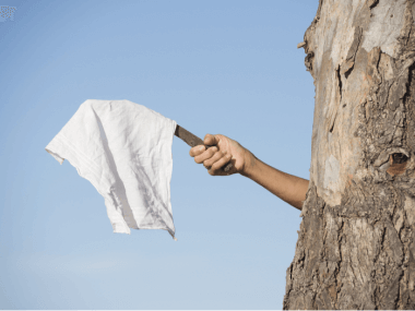 giving up with white flag