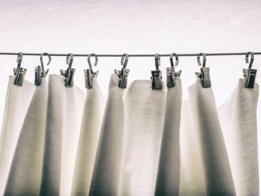 How to Get a Shower Curtain to Stop Sticking and Other Shower Curtain Hacks That Will Change Your Life