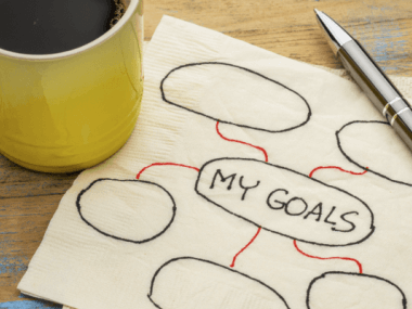 a napkin with someone setting goals on it