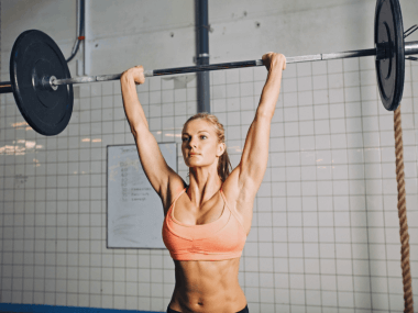 Photo of a woman doing an overhead press