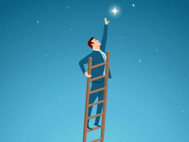 image of a man reaching for a star symbolizing his dream job