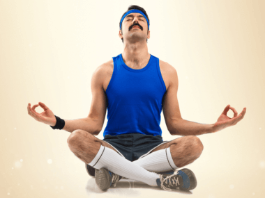 Photo of a man in lotus position ready to workout