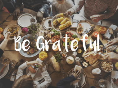 image of people being grateful over dinner table