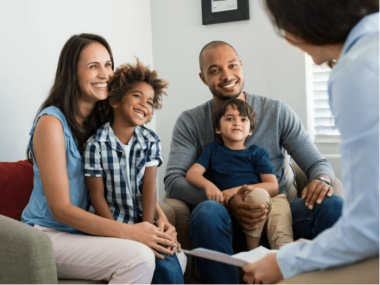 Family chatting with mental health specialist