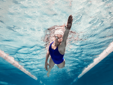 Photo of a woman swimming in a pool.