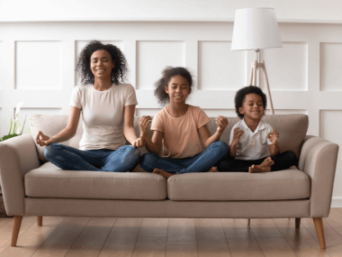 happy mom and children meditating