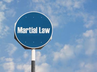 A sign that reads Martial Law