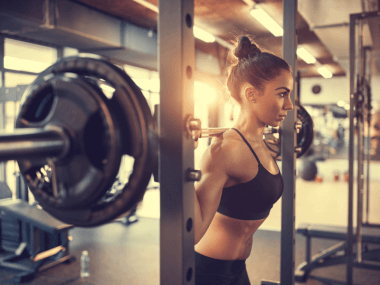 Photo of a woman lifting weights