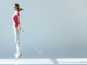 Photo of a woman jumping rope as part of her workout