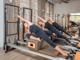Photo of people using a type of Pilates machine