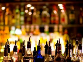 image of liquor bottles at a bar