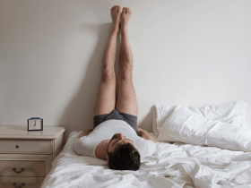 Picture of a man doing yoga in bed