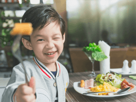 image of boy eating healthy food