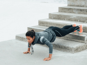 Photo of a woman doing a pushup variation