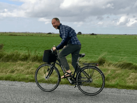 Photo of Brock on a bike in Denmark