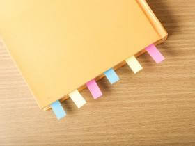 a style guide with certain pages tabbed with post-its