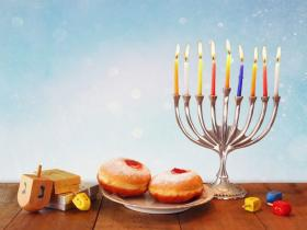 a menorah and other symbols of Hanukkah