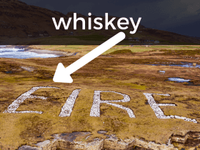Eire written on a hillside with an arrow pointing to the E