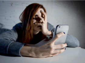 distressed woman scrolling Instagram