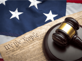 U.S. Constitution, American flag, and gavel