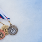 Photo of winter Olympic medals on ice