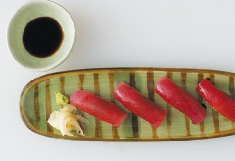 Arrange nigiri on a serving plate. Garnish with additional wasabi, ginger and a small dipping bowl of soy sauce