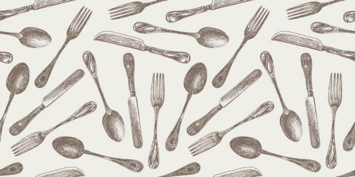 an image of forks spoons and knives symbolizing eating a lot