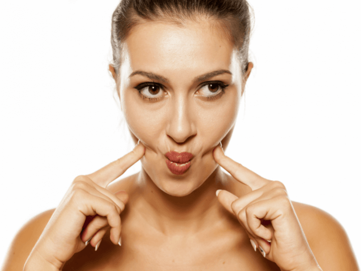 Woman doing face exercise