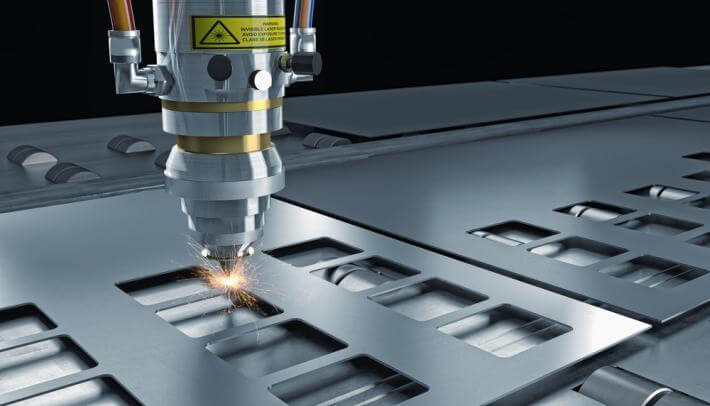 image of a laser cutting metal