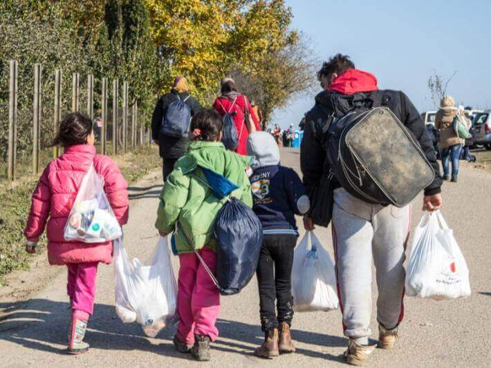 Photo of a family carrying shopping bags
