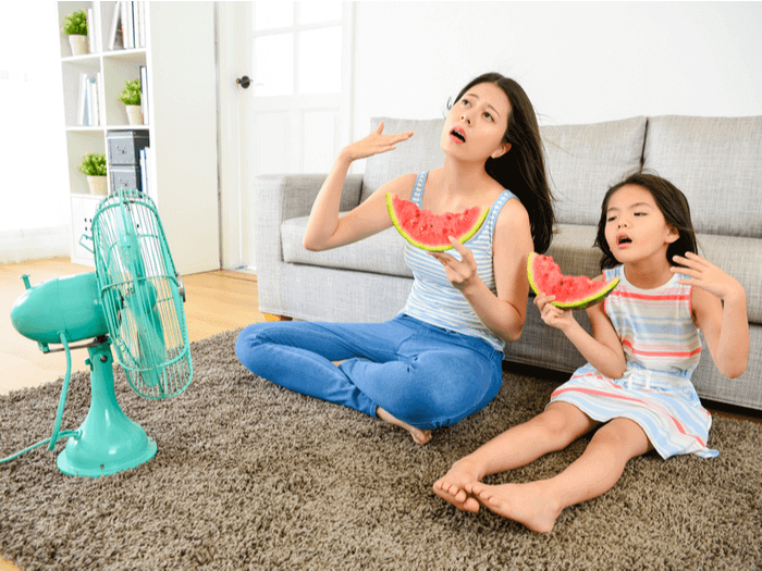 mom and child cooling off in front of fan