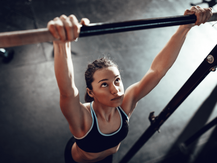 Photo of a woman too tired to do a chin-up