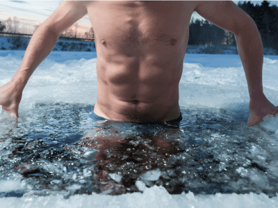 Photo of a man submerging himself in an ice bath
