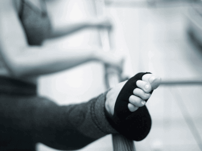 Photo of a woman's foot on a barre