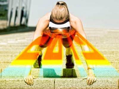 Photo of a woman doing pushups, wearing VR goggles