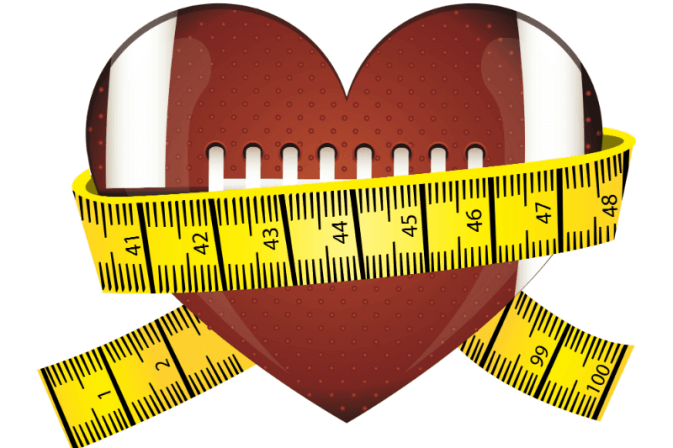 a football in the shape of a heart with measuring tape