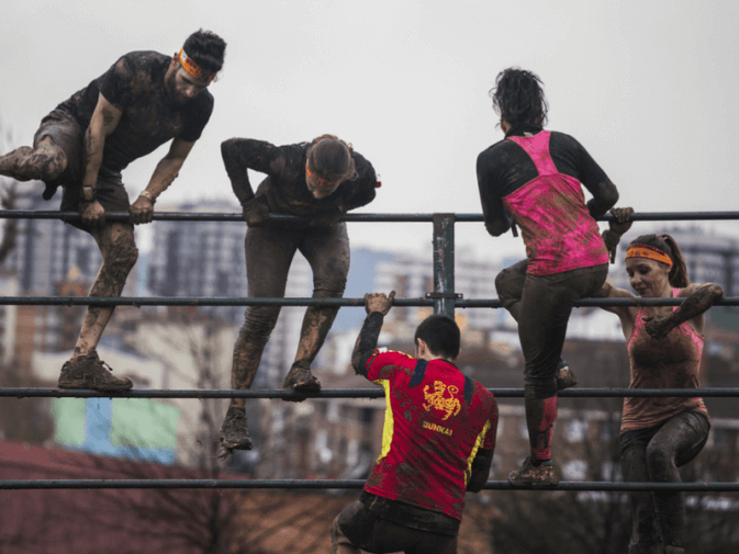 Photo of people doing an obstacle course race